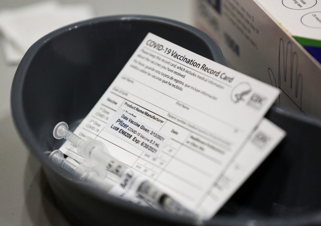 A Pfizer coronavirus disease (COVID-19) vaccine card is seen at a mass vaccination site at Lumen Field Event Center in Sea...