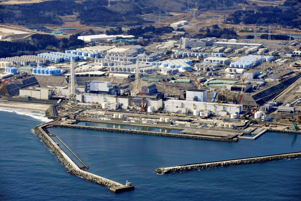An aerial view shows the storage tanks for treated water at the tsunami-crippled Fukushima Daiichi nuclear power plant in ...