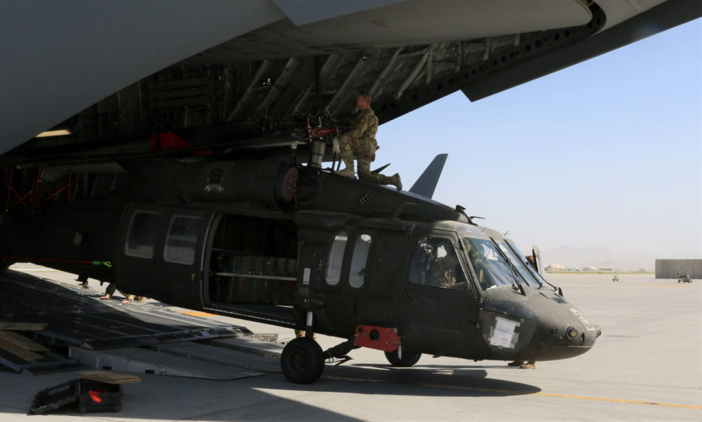 Blackhawk helicopter loaded onto U.S. transport plane during Afghanistan withdrawl