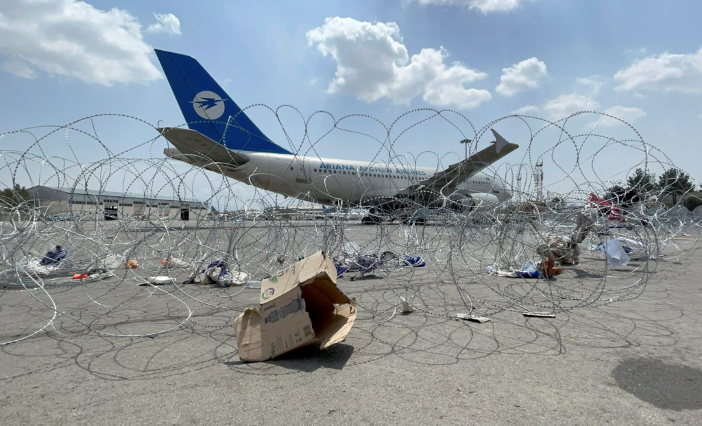 FILE PHOTO: A commercial airplane is seen at the Hamid Karzai International Airport a day after U.S troops withdrawal in K...