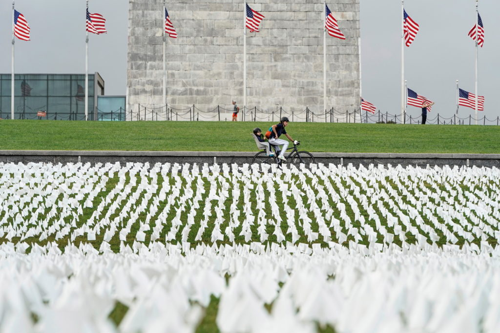 White flags representing Americans who have died of COVID-19 are placed on the National Mall in Washington