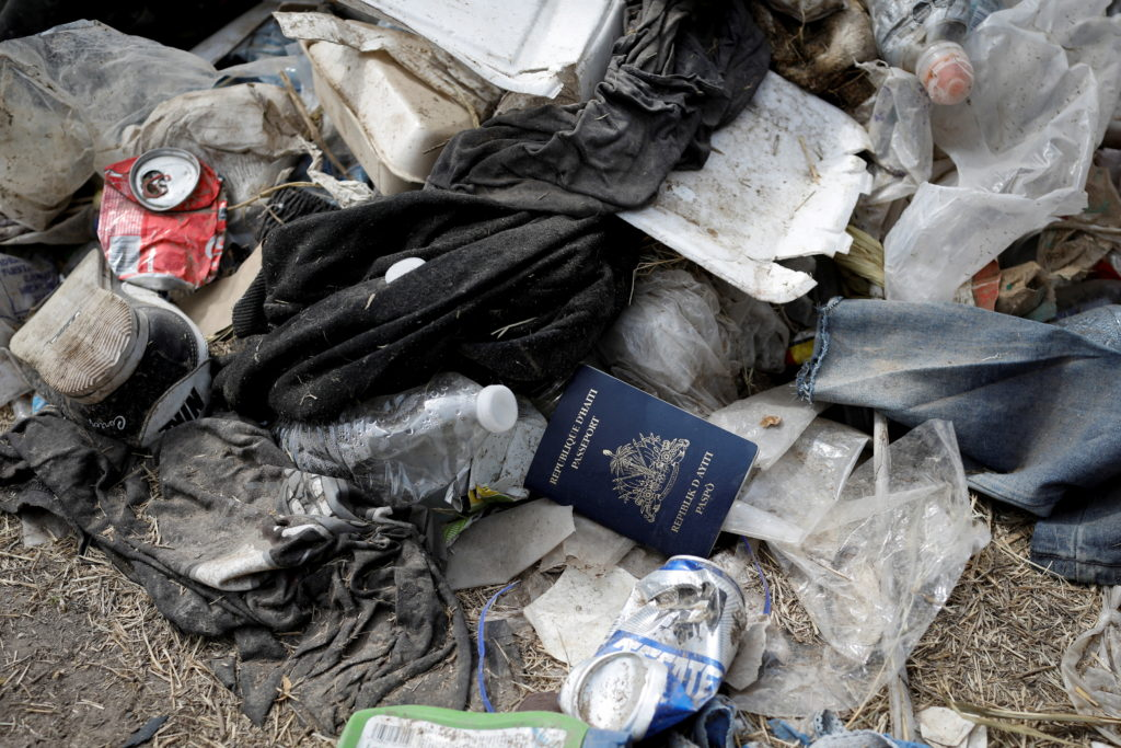 A Haitian passport is seen in a pile of trash near the International Bridge between Mexico and the U.S., where migrants se...