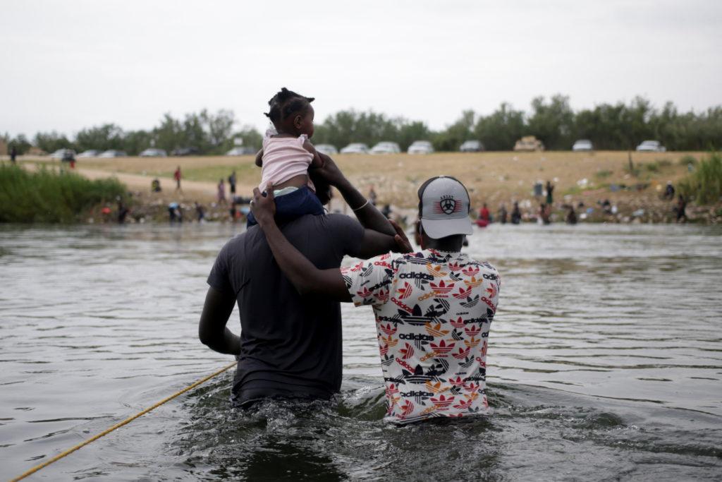 Migrants seeking refuge in the U.S. cross Rio Grande river, in Ciudad Acuna