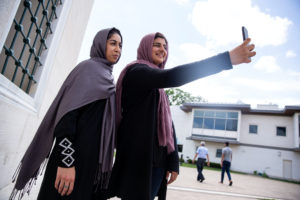 Two Muslim women take pictures after the first Friday prayers during the month of Ramadan at Diyanet Center of America in ...