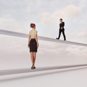 Gender inequality: man and woman on separate paths