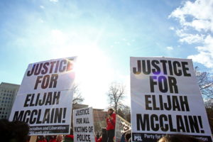 Protesters gather for a rally to call for justice for Elijah McClain in Denver