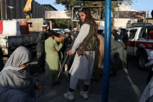 A Taliban soldier stands in one of the streets of Kabul