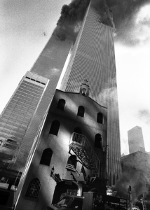St. Nicholas Greek Orthodox sits below the twin towers of the World Trade Center before they collapsed as a result of the Sept. 11, 2001, attacks.
