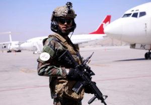 Member of Taliban forces stands guard at Hamid Karzai International Airport in Kabul