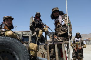 Members of the Taliban Intelligence Special Forces guard the military airfield in Kabul