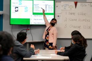 A teacher wears a mask inside Santa Fe South High School