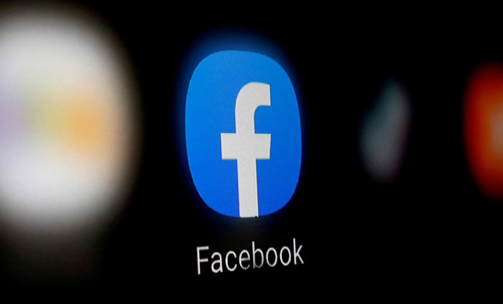 FILE PHOTO: A Facebook logo is displayed on a smartphone in this illustration