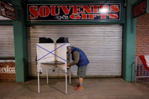 A voter fills out his ballot at Fenway Park on the first day of early voting in Boston