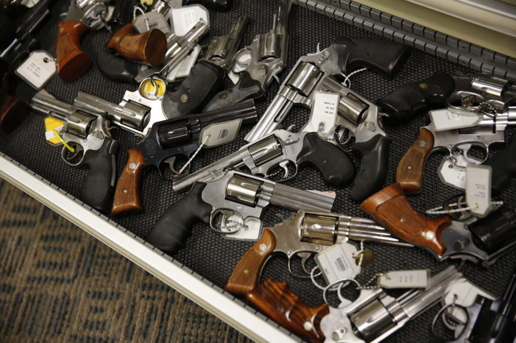 Handguns line the shelves in the gun library at the U.S. Bureau of Alcohol, Tobacco and Firearms National Tracing Center i...