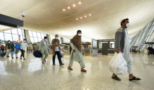 Afghan refugees arrive at Dulles Airport in Virginia