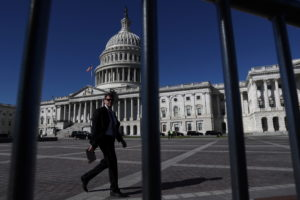 A man walks past the U.S. Capitol building as a government shutdown looms in Washington