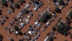 A satellite image shows houses along Boesel Avenue submerged in flood water in Manville, New Jersey, U.S., following torre...