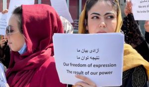 Afghan women's rights defenders and civil activists protest to call on the Taliban for the preservation of their achieveme...