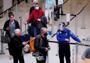 FILE PHOTO: Travelers at Seattle-Tacoma International Airport in SeaTac
