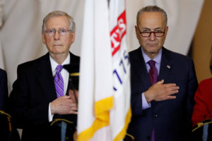 Senate Majority Leader Mitch McConnell and Senate Minority Leader Chuck Schumer look on during a ceremony to present the C...