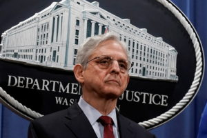 FILE PHOTO: U.S. Attorney General Merrick Garland announces that the Justice Department will file a lawsuit challenging a ...