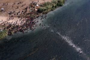 Migrants seeking refuge in U.S. cross back into Mexico