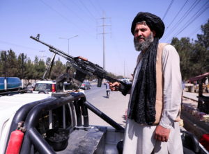 A member of the Taliban force stands guard at a checkpoint in Kabul
