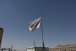 Flag of the Islamic Emirate of Afghanistan (Taliban) is raised at the military airfield in Kabul