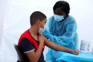 Coronavirus disease (COVID-19) vaccination event outside the Bronx Writing Academy school in New York City