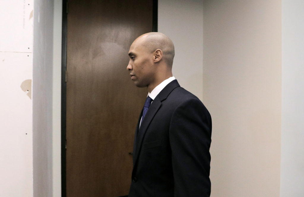 Mohamed Noor walks into the courthouse on the first day of opening arguments of the trial of former Minneapolis police off...