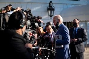 U.S. President Joe Biden speaks to reporters before departing for a trip to Wilmington, Delaware