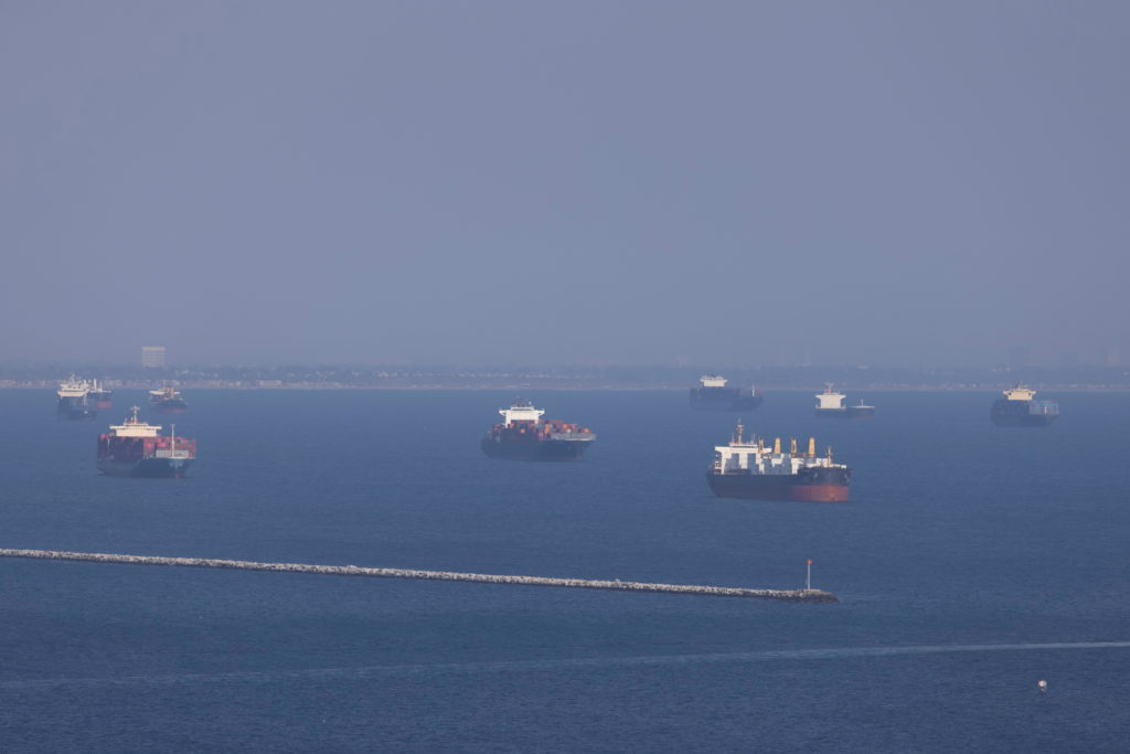 FILE PHOTO: Container ships wait off the coast of the congested ports of Los Angeles and Long Beach, in Long Beach
