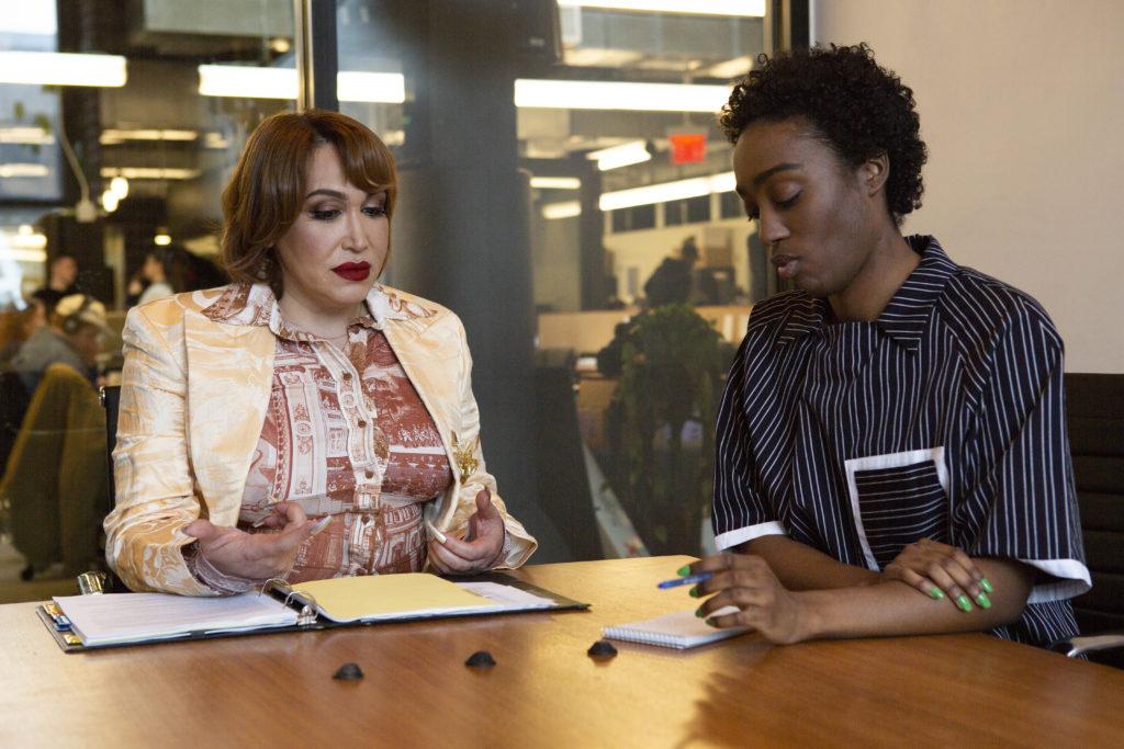 A-transfeminine-executive-meeting-with-a-non-binary-employee