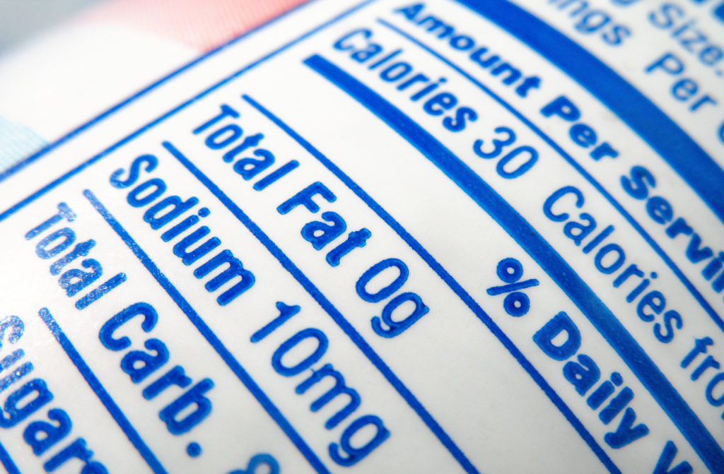 A nutrition label on an unknown food item shows calorie, fat and sodium content.