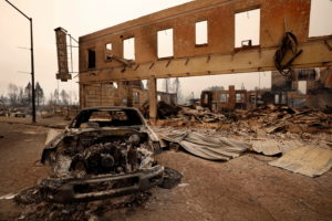 Burned out car and commercial building at the Dixie Fire in Greenville