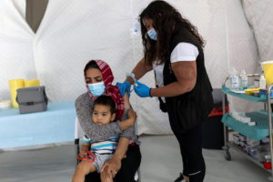 Vaccination against the coronavirus disease (COVID-19) in the Mavrovouni camp for refugees and migrants on the island of L...