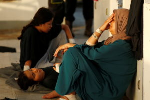 Injured migrants wait to be evacuated by the Italian Coast Guard from the German NGO migrant rescue ship Sea-Watch 3