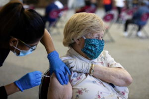 FILE PHOTO: People receive COVID-19 booster vaccination in Michigan