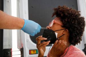 Akyiaa Wilson receives a coronavirus disease (COVID-19) test at a mobile testing van in New York