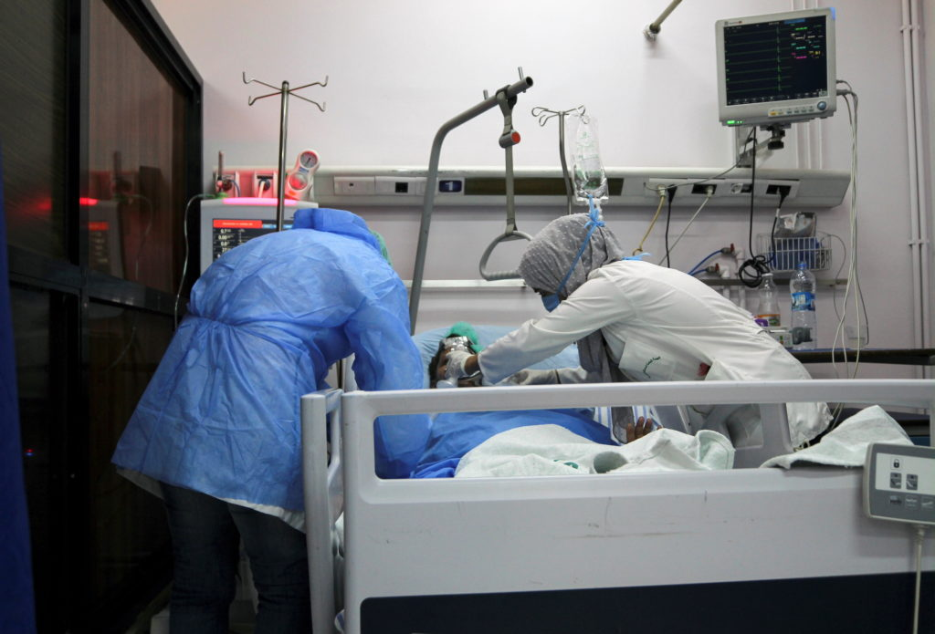 COVID-19 patients receive treatment inside a hospital in Damascus