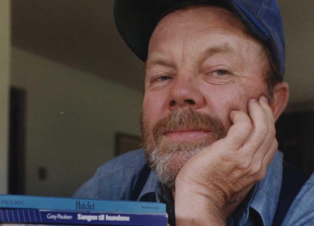 Gary Paulsen, author, is shown with some of his books. Photo is one of several for a feature on Paulsen in the Minneapolis...