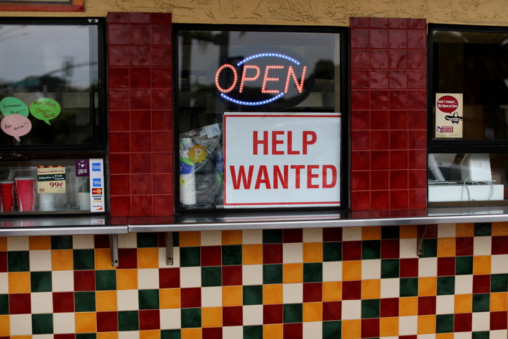 FILE PHOTO: A help wanted sign is posted at a taco stand in Solana Beach, California, U.S., July 17, 2017